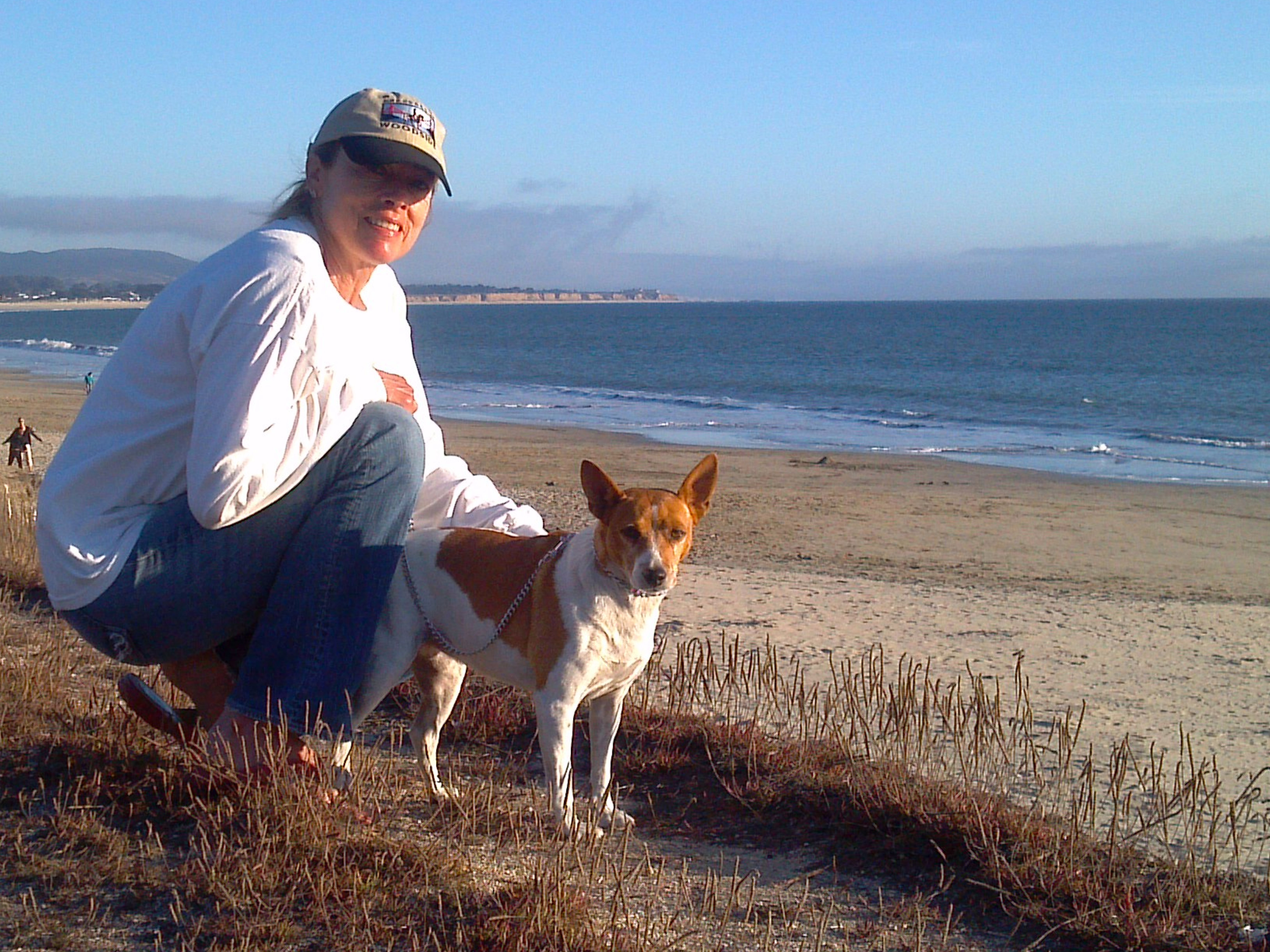 Renee Johnson with Goldie at the beach after the rat terrier's surgery.
