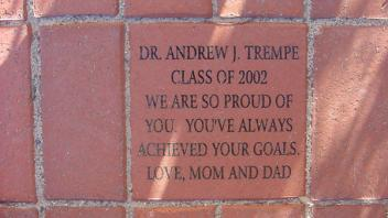 Dr. Andrew J. Trempe. Class of 2002. We are so proud of you. You've always achieved your goals. Love, Mom and Dad
