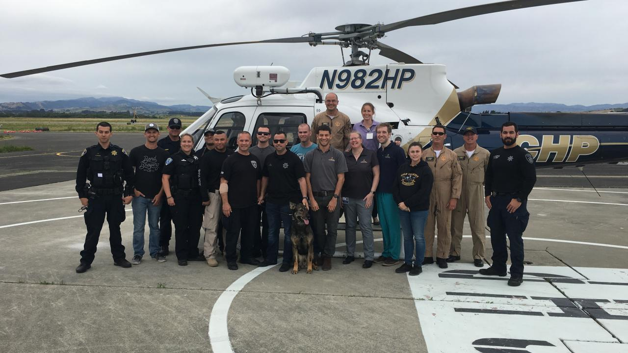 Police and UC Davis veterinarians with CHP helicopter