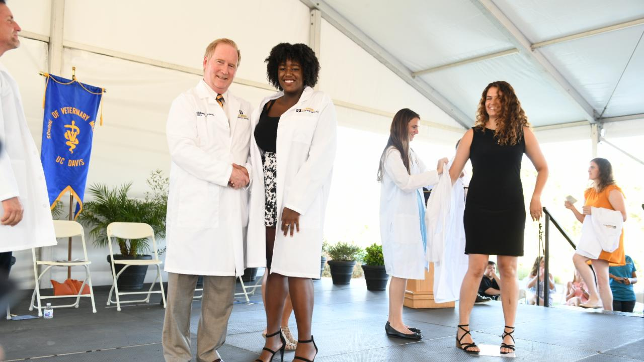 Incoming students received white coats