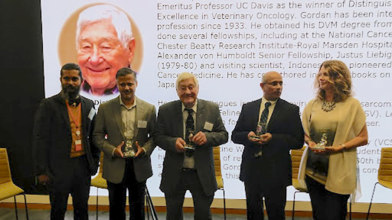 Dr. Gordon Theilen is pictured in the center of the impressive row of award winning researchers.