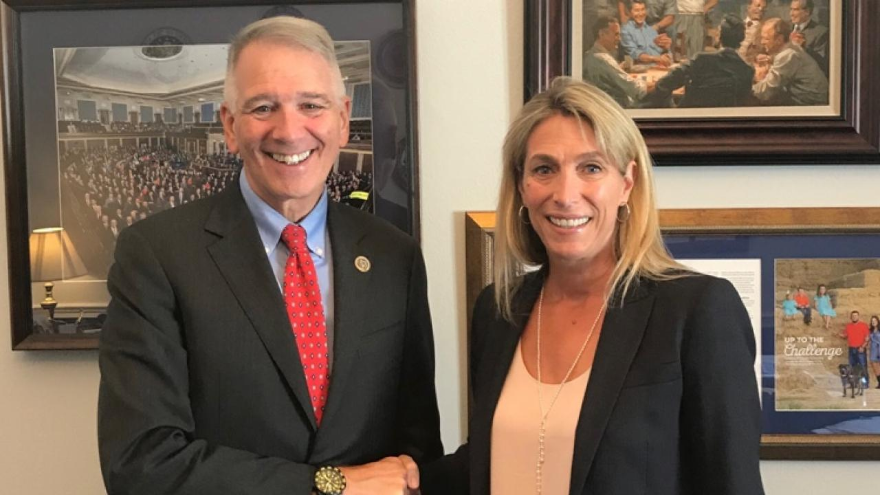 Dr. Johnson (right) discussed One Health issues with members of Congress, including  Congressman Ralph Abraham (R-LA), a veterinarian and physician.