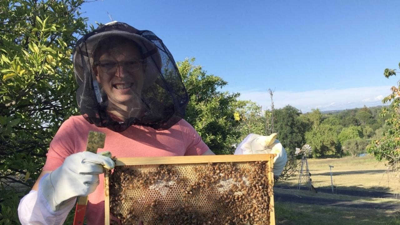 Dr. Jonathan Dear with his honeybees