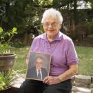 Annette Parker holds a photo of her late husband, Dr. Harold Parker '52.