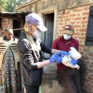 Cara Newberry, Class of 2022, sampling chickens in Tanzania.