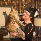 Kate Benjamin in 2013 with one of her many cats, who are now helping her through her cancer treatment.