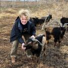 Tracey Stevens offers feed to rescued San Clemente Island goat at Sabatka Farms in Weston, NB, following devastating floods
